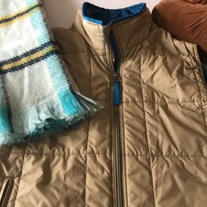 EUC Patagonia tan with turquoise lining L vest.❤️